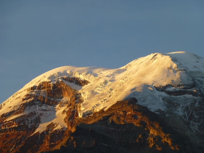 Sunrise reflection on the icy mountains of Chimborazo